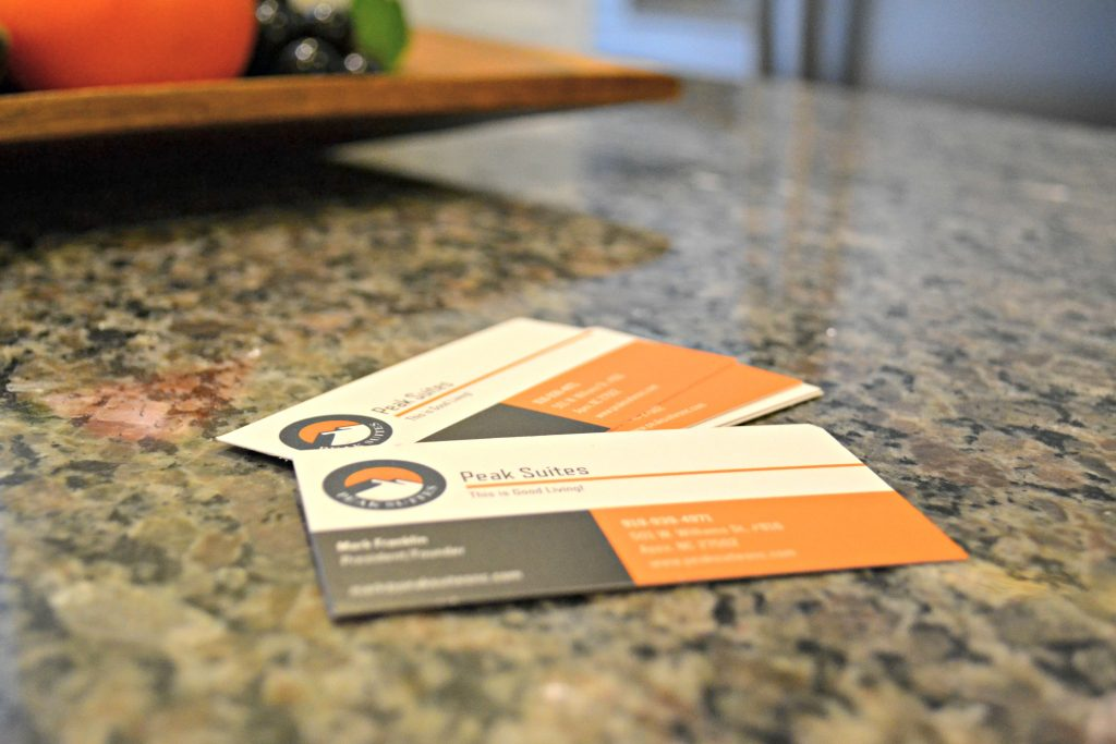 Peak Suites business cards on kitchen counter top