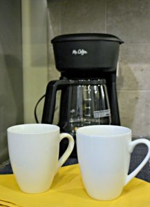 Peak Suites kitchen in luxury furnished apartment, close up of coffee pot and two coffee mugs