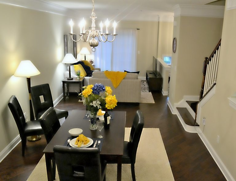 Peak Suites furnished apartment dining table and couch