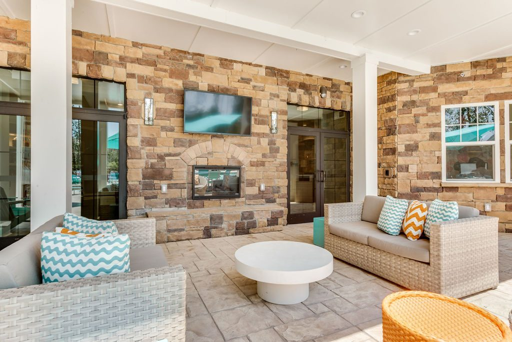 Outdoor Lounge area with television