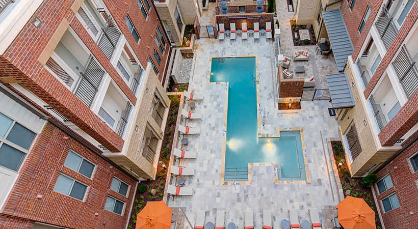 View of pool from top story of building