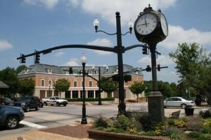 Downtown Cary intersection with traffic light and clock