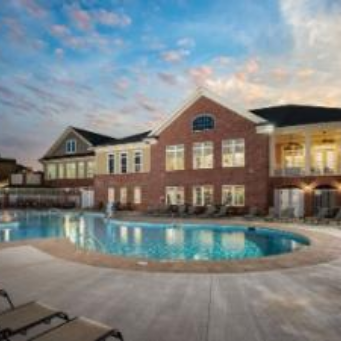 Apex Villages at Westford outdoor pool with furnished apartments building